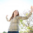 Woman being playful with her arms outstretched — Stock Photo #48446261