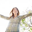 Woman being playful with her arms outstretched — Stock Photo #48446421