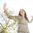 Woman being playful with her arms outstretched — Stock Photo #48446525
