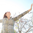 Woman being playful with her arms outstretched — Stock Photo #48446533