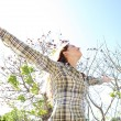 Woman being playful with her arms outstretched — Stock Photo