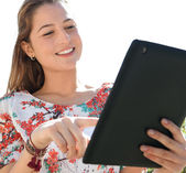 Woman in a park using a digital tablet — Stock Photo