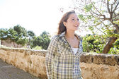 Woman walking along a high path in a park — Stock Photo