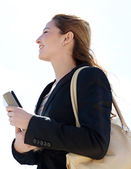 Businesswoman carrying work folders — Stock Photo