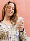 Woman holding a smartphone — Stock Photo
