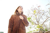 Woman wearing a leather coat — Stock Photo