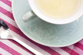 Tea cup and saucer on a kitchen — Stock Photo