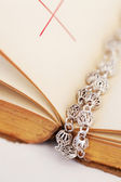 Bible book with a silver beads rosary — Stock Photo