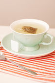 Cup of hot tea brewing in green porcelain cup — Stock Photo