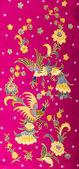 Beautiful pattern batik on red background — Stock Photo