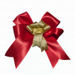 Red and gold ribbon on white — Stock Photo