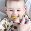 Baby boy eating vegetable mash — Stock Photo