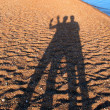 Courting couple shadow on beach in Egypt — Stock Photo #20233193