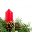 Christmas - wreath from fresh twigs and cones with red candle - Stock Photo