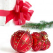 Royalty-Free Stock Photo: Christmas ball and gift box with red ribbon