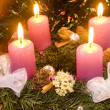 Christmas wreath with violet candles — Stock Photo