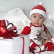 Stock Photo: Picture of baby boy in diaper with big gift box