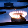 One blue flame on gas stove — Stock Photo