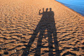 Courting couple shadow on the beach in Egypt — Stock Photo