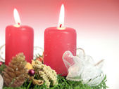 Christmas - wreath from fresh twigs and cones with two candle — Stock Photo