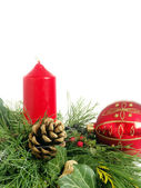 Christmas - wreath from fresh twigs and cones with red candle — Stock Photo