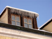 Two old windows with icicles — Stock Photo