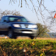 Blurred car on street — Stockfoto
