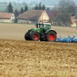 Tractor  on a field — Stockfoto