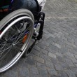 Wheelchair on cobblestones — Stock Photo #20504357