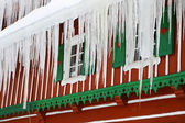 Windows with icicles — Stock Photo