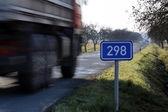 Blurred truck on street — Stock Photo