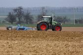 Tractor on a field — Stock Photo