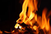 Fire and flames on a black background — Stock Photo
