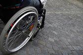 Wheelchair on cobblestones — Стоковое фото