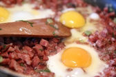 Three egg with cut sausage — Stock Photo