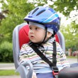 Child sitting in bicycle — Stock Photo