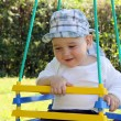 Child on swing — Stockfoto