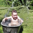 Child bathing outdoors — Stock Photo