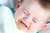 Crying baby boy eating — Stock Photo