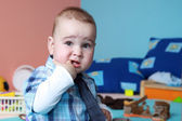 Child in nurser with tie — Stock Photo