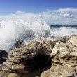 Impact of waves against rocks — Stock Photo #20589607