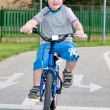 Baby boy on traffic playground for childs with crash helmet — Stock Photo #21678289