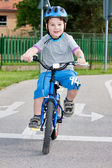 Baby boy on traffic playground for childs with crash helmet — Stock Photo