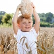 Stock Photo: Little boy with bread