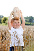 Little boy with the bread — Stock Photo