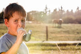 Boy using inhaler for asthma — Stock Photo
