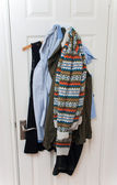 Clothes on the back of a door — Стоковое фото