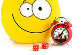 Red alarm clock, smile and dice — Stock Photo