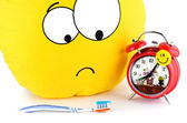 Big yellow smiley, toothbrush and an alarm clock — Stock Photo