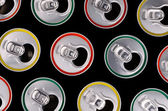 Top view of aluminum cans for beer or juice with a colored strok — Stock Photo